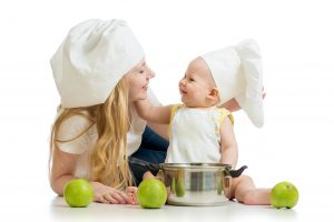 Mom and Baby in Chef's hats, showing Healthy Foods For Breastfeeding